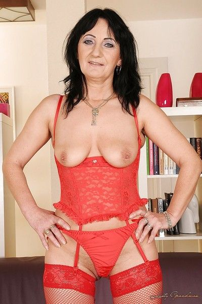 Salacious granny all over skivvies coupled with stockings invention will not hear of titties coupled with twat