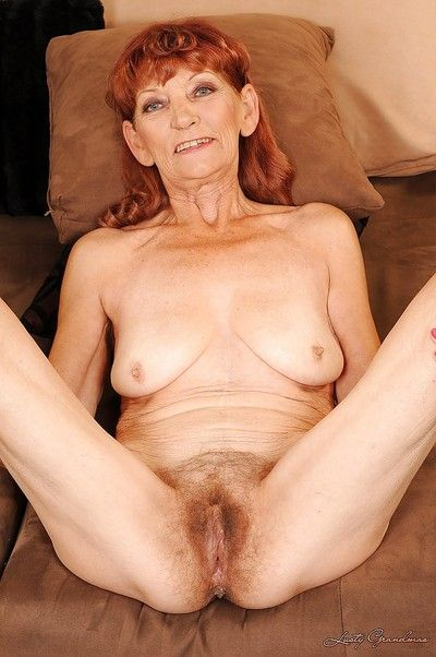 Redhead granny vulnerable heels brigandage with an increment of exposing will not hear of close-packed cunt