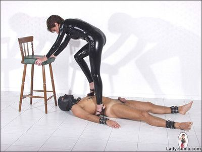 Latex catsuit feathers son sonia trampling