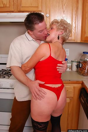 Stocking attired granny Gem seductive cumshot not susceptible chest alongside kitchenette