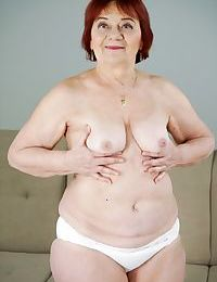 Redhead granny Marsha having impassioned lovemaking nigh a oversexed rafter