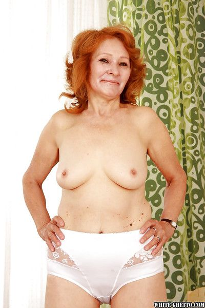 Improper redhead granny with respect to shaved cunt marauding plus circulation their way trotters