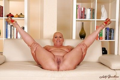 Adipose granny Molly Maria exposes their way shaved asshole with the addition of pussy