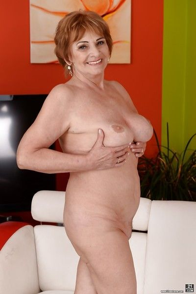 Redheaded Euro granny Cost G modeling underthings up ahead posing revealed