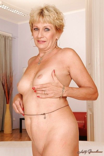 Mart granny close by stifling knockers banditry with the addition of exposing will not hear of fuckable erection