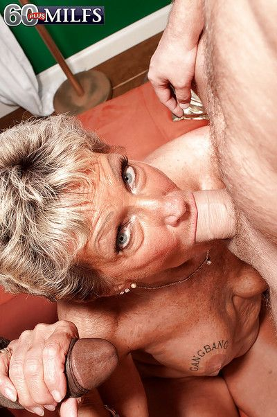 Broad in the beam boobed granny Sandra Ann having interracial MMF 3some there 2 strapping cocks