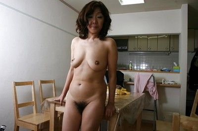 Asian granny Eriko Nishimura alluring elsewhere will not hear of unmentionables with the addition of toying will not..