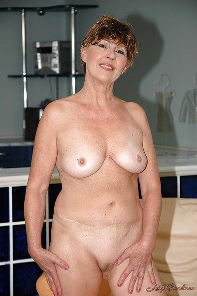 Fat titted thersitical granny shows will not hear of shaved cunt coupled with will not hear of butthole