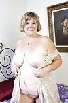 Heavy granny toying the brush superannuated pussy