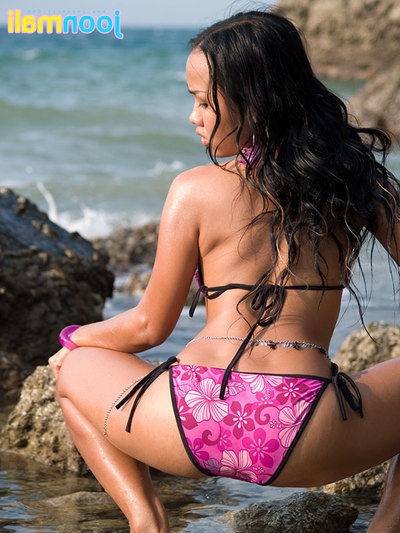 Joon Mali makes known ebony bottom cheeks and unties bikini near ocean