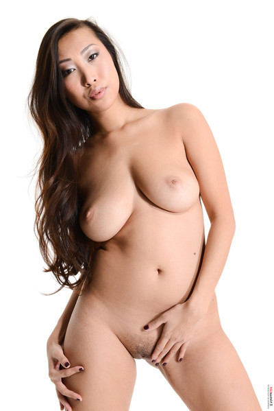 Curvy Chinese hotty stripped off exclusive of her shirt and strings