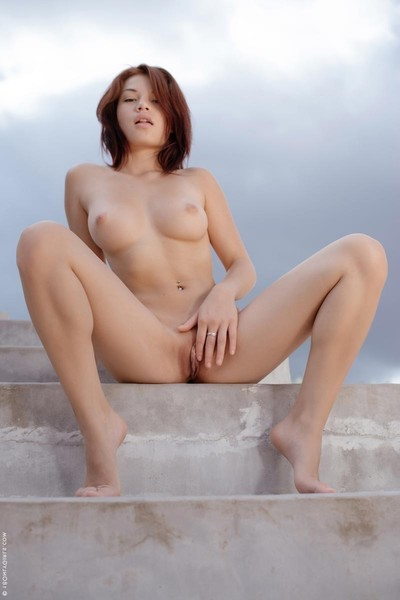 Concupiscent decadent chicito disrobes off her panties on the stairs
