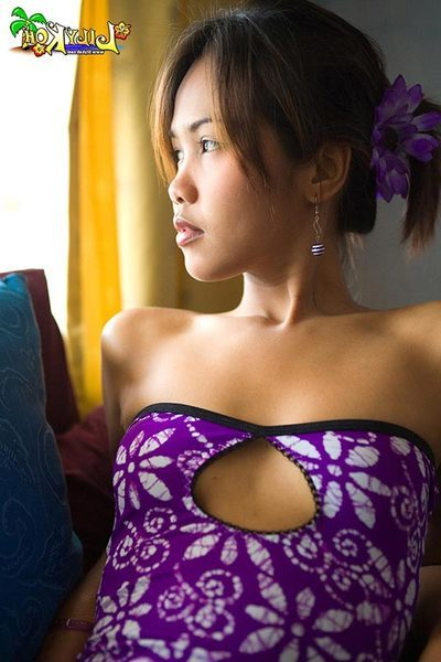 Lily Koh flashes white cotton underwear beneath a purple costume