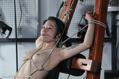 Sweet oriental adolescent in playroom rope slaving