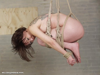 Elegant Chinese chicita is bound up in strict rope submission and then susp