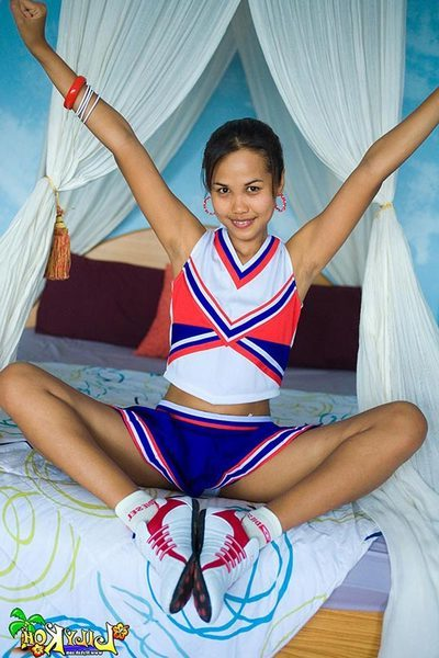 Fond Japanese youthful cheerleader flashes cotton underclothing