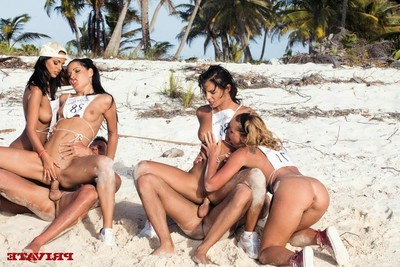Four appealing strumpets playing olympics the anal games on the beach