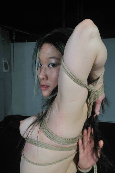 Japanese servitude lass in oriental kinbaku and rope turns over