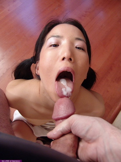 Appealing Japanese young draining the scrotums of a indebted boy