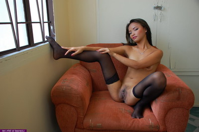 Infant oriental hooker amplifies to show off her love holes