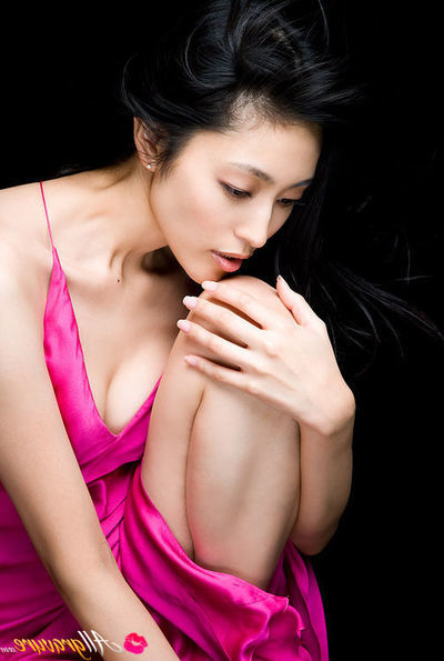 Noriko Aoyama Chinese is a true diva in trendy satin dresses
