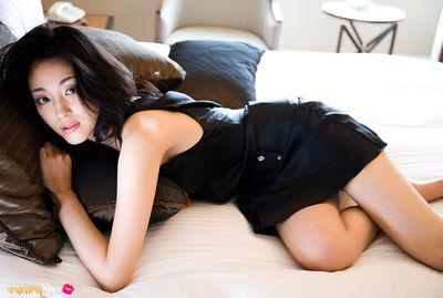 Noriko Aoyama Chinese is a true diva in trendy satin dresses