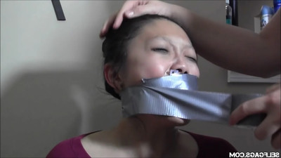 Oriental doxy united gagged and strained to sperm