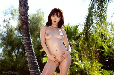 Eastern pornstar takes her clothes off in nature