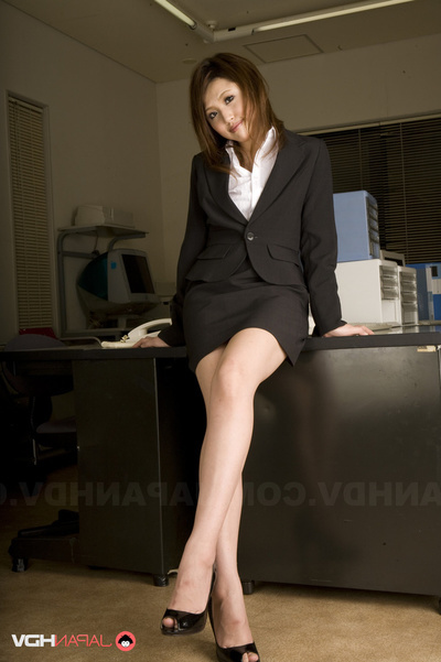 Office Lass In Glasses Wearing A Swarthy Outfit Flashes Her Shorts At Her Desk.