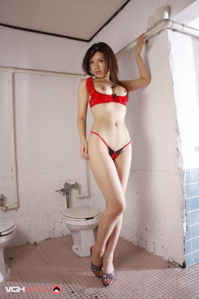 Broad In Skimpy Red Sexy pants Teasing On A White Toilet.