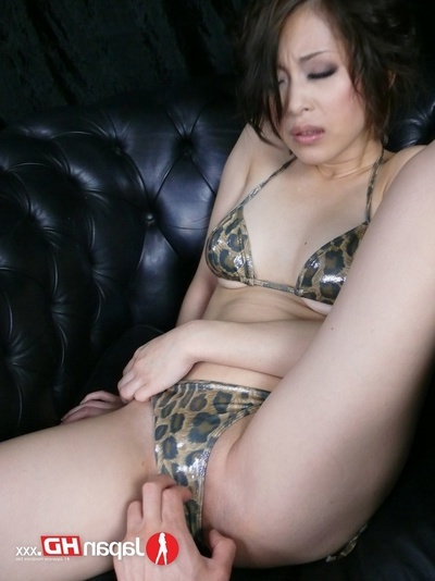 Wild Japanese Darling Wearing Cock Skin Bikini Displays Her Sticky Pointer sisters Then Takes Off Her Panty And Lets A Gentleman Rub A White Sex toy On Her Crack Making It Explode With Piddle On A Tiny Ebony Sofa.