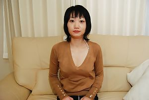 Shy Chinese MILF removes clothes down and receives her hairless muff filled with a instrument