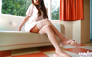 Seductive Japanese beauty with large jugs erotic dancing off her nurse uniform