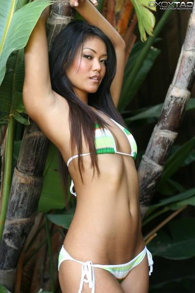 Slim oriental angel with petite titties