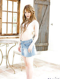 Attractive Japanese girl in miniskirt Ria Sakurai uncovering her miniscule changes direction