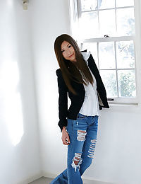 Graceful Chinese model in jeans Seira Narumi sluggishly striptease