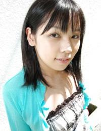 Chinese young Minami Ozaki getting stripped and exposing her unshaven snatch