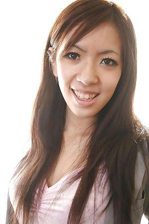 Japanese juvenile Harumi Matsuda undressing and exposing her babe pot