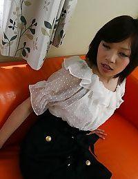 Chinese hottie Megumi Morishima undressing and expanding her legs