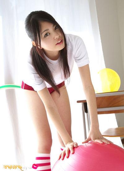 Nagisa Matsayama in sports apparatus plays with vast red testicle