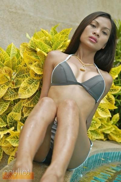 Thai grown up pattern tailynn posing sensually by the pool