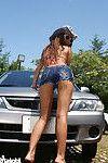 Japanese youthful in underclothing washing car outside