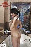 Slender Chinese adolescent pretty body shaving legs in washroom
