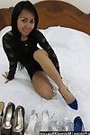 Thai darling shows submissive her shoe collection