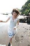 Japanese av idol saki koto playing on beach