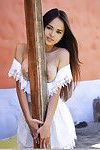Appealing Oriental Lass Takes Her White Sundress To Drip Wild Figure.