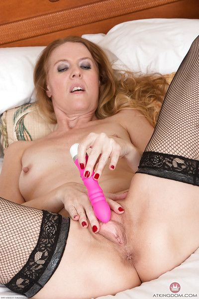 Older redhead with proximal tits in fishnet stockings masturbating with sexual relations gewgaw