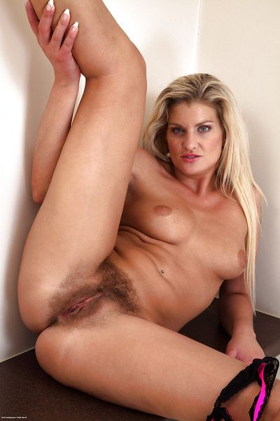 Of age blonde milf Samantha Snow with regard to unshaved and horny vagina