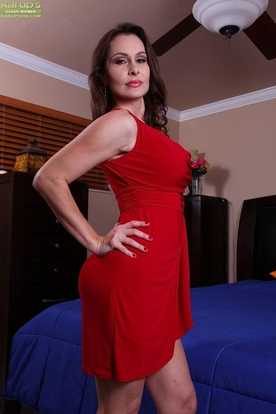 Big knockers mature beauty Nora Noir posing round superb red underwear