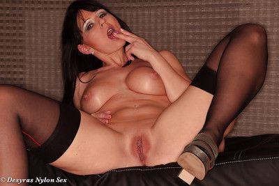 Topless Euro woman Desyra Noir posing all round skirt and stockings